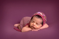 Newborn-baby-tummy-pose-with-bonnet